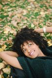 Autumn relax and happiness. Young black happy woman relaxing in autumn. Happiness and relax concept Royalty Free Stock Photography