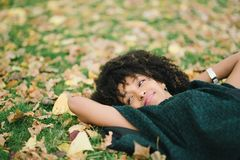 Autumn relax and happiness. Young black happy woman relaxing in autumn. Happiness and relax concept Stock Photo