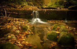 Autumn river. A little waterfall on the Slanic-Moldova river Royalty Free Stock Photo