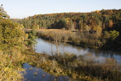 Autumn river and countryside. Scenic view of autumnal forest by river, Michigan, U.S.A stock photography
