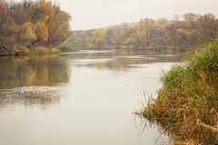 Autumn river, landscape, cloudy weather royalty free stock image