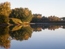 Autumn River Reflections 18. Lazy River fall foliage near sunset Stock Photos