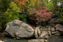 Autumn River Scene. A beautiful autumn scene along the Rocky River in Berea Ohio. Giant sandstone boulders sit in the river giving it its name royalty free stock image