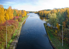 Autumn river scene. View of the embankment of the river with autumn trees Royalty Free Stock Photography
