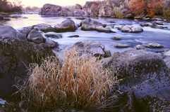 Autumn river with a swift current, rapids, rocks Royalty Free Stock Photos