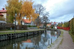 Autumn by the river in Trosa. Beautiful  walk along Trosa river in autumn colors Royalty Free Stock Photography