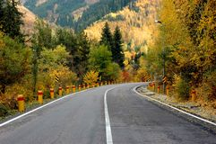 Autumn road. Autumn asphalt road in mountains Stock Photo