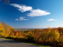 Autumn road. In Gatineau Park, Hull, Canada. Ottawa river valley in background royalty free stock images