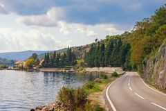 Autumn road along the sea. Montenegro, Bay of Kotor Adriatic Sea. Near ferry and Kamenari town stock photos