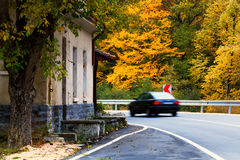 Autumn road and car Stock Photography