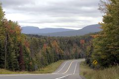 Autumn Road Curve. A road through the Adirondacks in Early Autumn Royalty Free Stock Photos