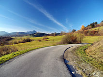 Autumn road at Liptov, Slovakia. Autumn view of road going trough colorful countryside of Liptov region, northern Slovakia. Great Choc (Veľký Choč) mountain Royalty Free Stock Photography