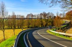 Autumn road scene Stock Images
