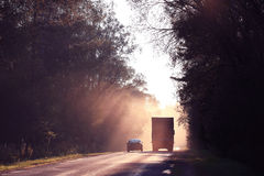 Autumn road sunset, the rays of light, the journey Royalty Free Stock Image