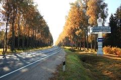 Autumn road sunset, the rays of light, the journey Stock Photo