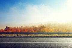 Autumn road. In sunset time royalty free stock images