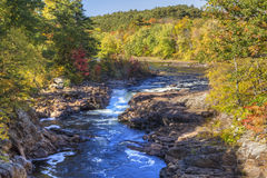 Autumn on Rockwell Falls. Rockwell Falls on the Hudson RIver in the town of Lake Luzerne in the Adirondack Mountains of Nw York Stock Photos
