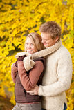 Autumn romantic couple happy hugging in park Royalty Free Stock Images