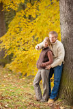 Autumn romantic couple smiling together in park Royalty Free Stock Images