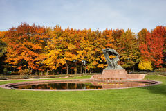 Autumn at Royal Lazienki Park in Warsaw. Fryderyk Chopin monument and pond in autumn Royal Lazienki Park in Warsaw, Poland stock photo