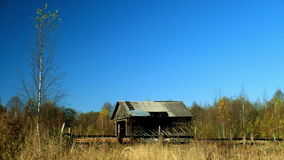 Autumn rural landscape with abandoned farm. Clear sunny weather stock video