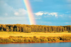 Autumn rural landscape - birds eye view of autumn forest and bright rainbow Stock Photography