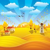 Autumn rural landscape with houses and fields Stock Photo