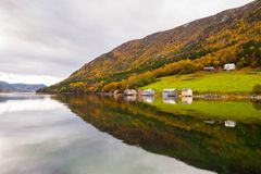 Autumn rural landscape with houses near river, Norway Stock Photo