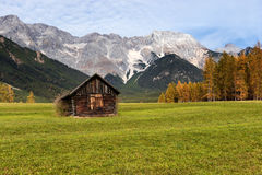 Autumn rural scenery of Miemenger Plateau with rocky mountains peaks in the background. Austria, Europe, Tyrol Royalty Free Stock Photography