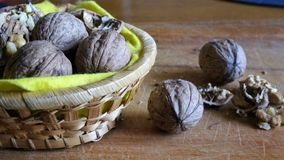 Walnuts whole and cracked in old baskets. Close-up, healthy food with rustic background stock photography