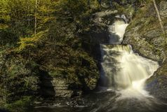 Autumn`s scent. Delaware Water Gap, PA. Beautiful autumn waterfall at Delaware Water Gap National Recreation Area in Pennsylvania with fading rainbow royalty free stock photo