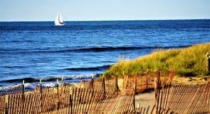 Free Autumn Sailing By Winterized Lake Michigan Beach Stock Photo - 105487060
