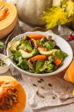 Autumn salad from baked pumpkin, beet, zucchini and carrots. Healthy vegan food concept. Autumn food concept stock photo