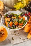 Autumn salad from baked pumpkin, beet, zucchini and carrots. Healthy vegan food concept. Autumn food concept stock images