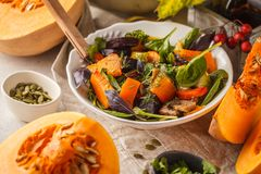 Autumn salad from baked pumpkin, beet, zucchini and carrots. Healthy vegan food concept. Autumn food concept royalty free stock photo