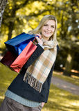 Autumn sale. Young happy beauty woman with shopping bags Stock Image