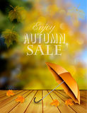 Autumn sale background with an umbrella. Royalty Free Stock Image