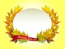 Autumn sale banner in frame from autumn leaves. Stock Photos