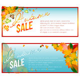 Autumn sale banners with orange leaves. Autumn sale banners with foliage from falling leaves and percents of discounts inside on gradient blue white background Stock Image