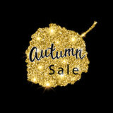 Autumn Sale brush lettering. Gold glitter banner design with sparkles on black background. Seasonal discount fall poster Royalty Free Stock Photography