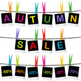Autumn sale concept with photo frames hanging on clothespins Royalty Free Stock Photos