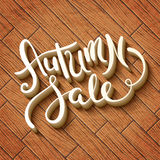 Autumn sale. Hand made lettering Autumn sale over wooden background Royalty Free Stock Photography