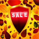 Autumn sale label over a shield Stock Photography