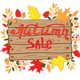 Autumn sale lettering composition for design. Wooden plank. A wreath of orange and yellow leaves, berries and acorns vector illustration