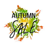 Autumn sale lettering with maple leaf Stock Photos
