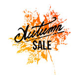 Autumn sale lettering with maple leaf Royalty Free Stock Photo