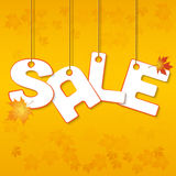 Autumn Sale. Letters hanging on ropes with leaves stock illustration