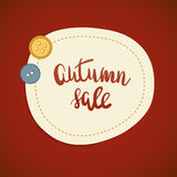 Autumn sale or offer banner design. Lettering text Autumn sale and two cute buttons on dark red background. Stock Photography