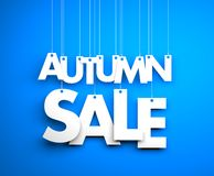 Autumn sale - text hanging on the strings Stock Photo