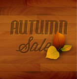 Autumn sale vector wooden background. With colorful leafs Royalty Free Stock Images
